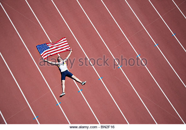 Runner laying on track with American flag - Stock Image