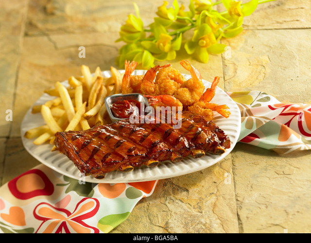 BBQ pork short ribs with fried shrimp and fried potatoes - Stock Image