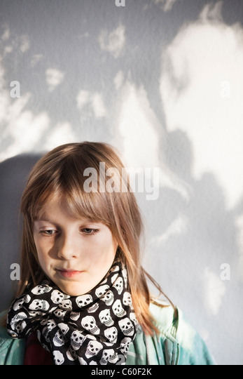 Girl wearing skull-pattern scarf - Stock Image