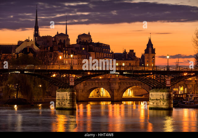 Sunrise on Ile de la Cite with view on the Pont des Arts, Pont Neuf and the Seine River. 1st Arrondissement, Paris, - Stock Image