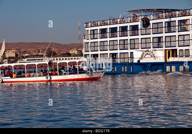 Aswan small colorful passenger ferry boat Nile River Aswan Egypt traditional transport vessel nile cruise ship - Stock Image