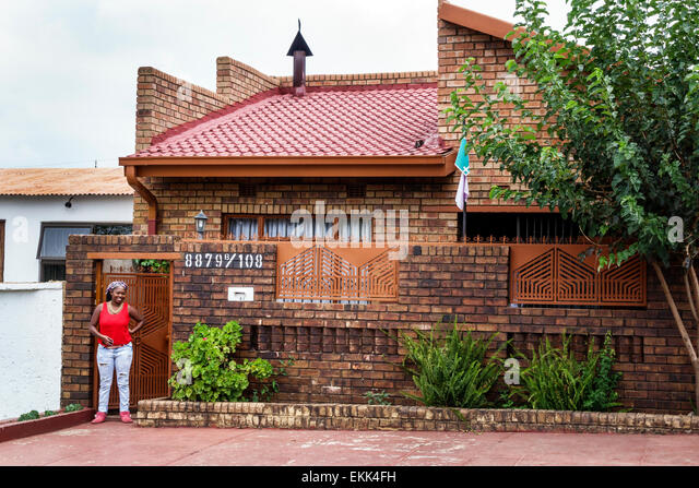 South Africa African Johannesburg Soweto Black woman home front - Stock Image