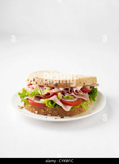 Ham and tomato sandwich on plate - Stock Image