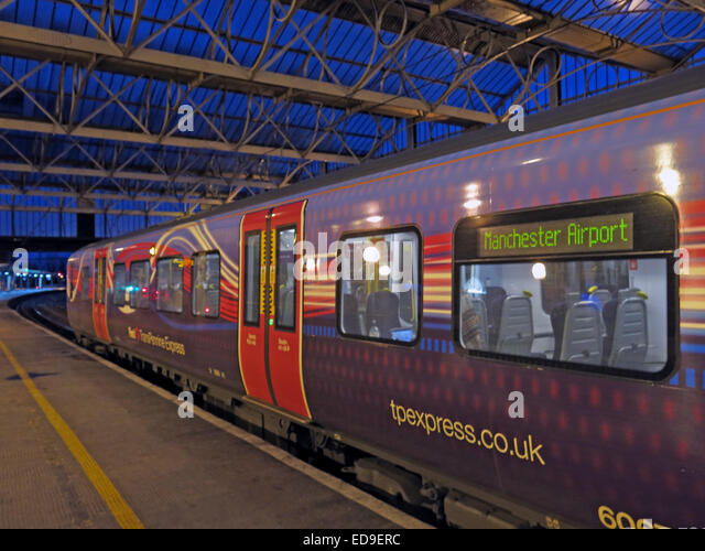 First transPennine Express train for Manchester Airport at dusk at Carlisle station - Stock Image