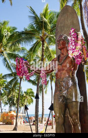 Hawaii Hawaiian Honolulu Waikiki Beach resort Kuhio Beach State Park Duke Kahanamoku statue surfer Olympic swimmer - Stock Image