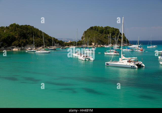 Yachts anchored in bay, Lakka, Paxos, Ionian Islands, Greek Islands, Greece, Europe - Stock Image