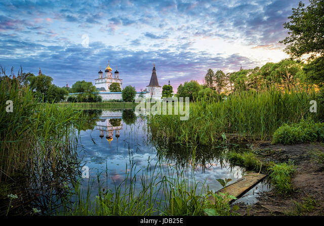 Joseph-Volokolamsk Monastery reflecting in pond on sunset, Moscow oblast, Russia - Stock Image
