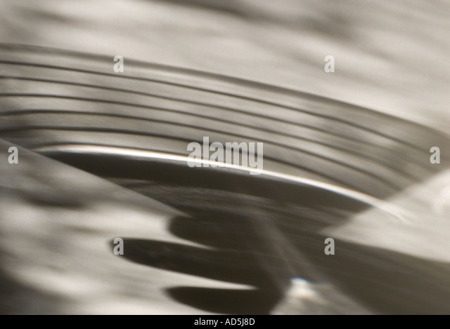 Shadow of a hand with a martini glass - Stock Image