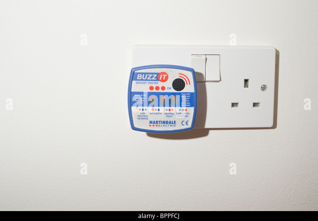 A Buzz It socket tester used by an electrician for testing faults in electrical systems - Stock Image