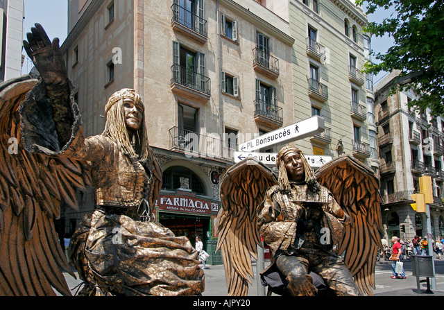 spain Barcelona ramblas street artists angel costums - Stock Image