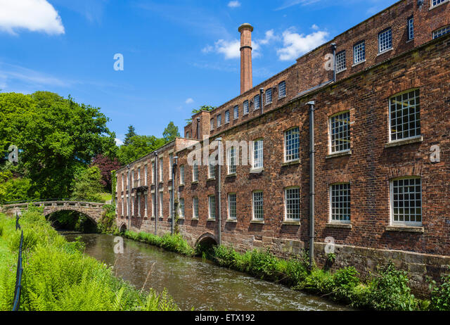The River Bollin and Quarry Bank Mill, a historic 18thC textile mill in Styal, Cheshire, England, UK - Stock Image