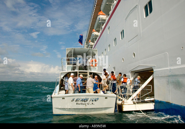 Belize City Central Latin America cruise ship passengers using tender ferry - Stock Image