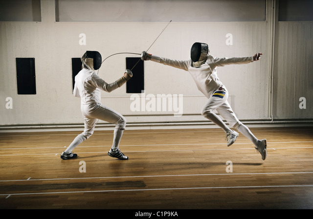 Two fencers in sports hall - Stock Image