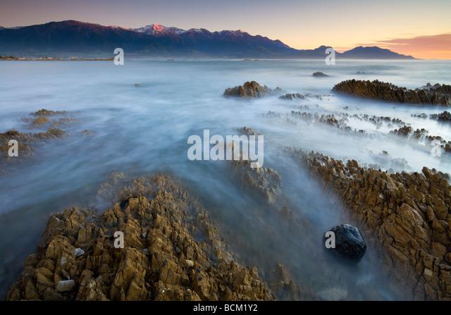 First light glows on the mountains of the Seaward Kaikoura ranges Kaikoura South Island New Zealand May 2007 - Stock Image