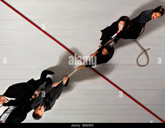Business people pulling each other - Stock Image