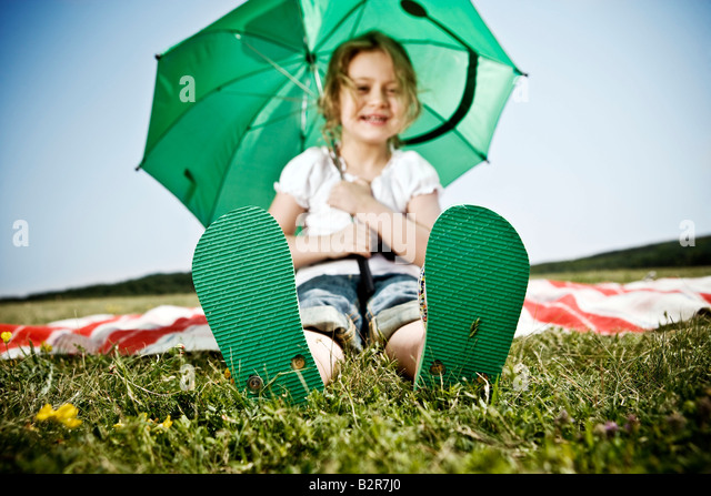 Girl wearing green shoes - Stock Image