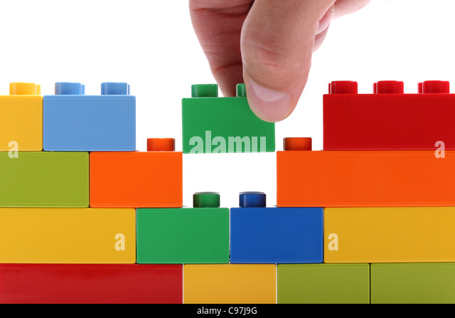 Building a wall from blocks - Stock-Bilder