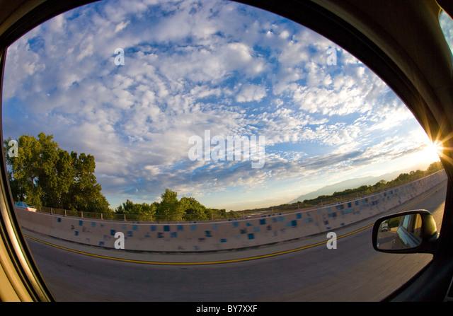 blue sky of New Mexico, USA, as seen through car window, fisheye lens - Stock Image