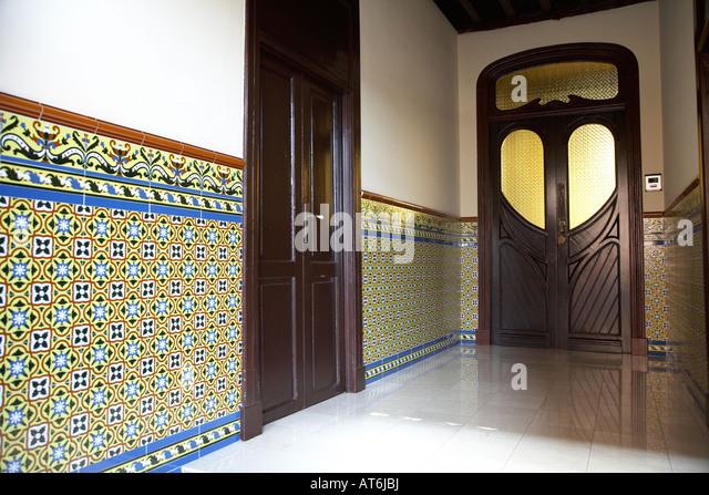 wooden doorway and tiled entrance hall to house door in la laguna tenerife canary islands spain - Stock Image