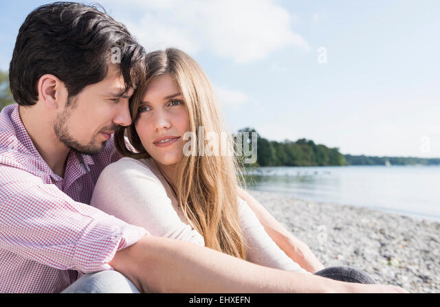 Lake beach young romantic couple portrait - Stock-Bilder