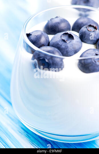 Blueberry and yogurt in glass - Stock Image
