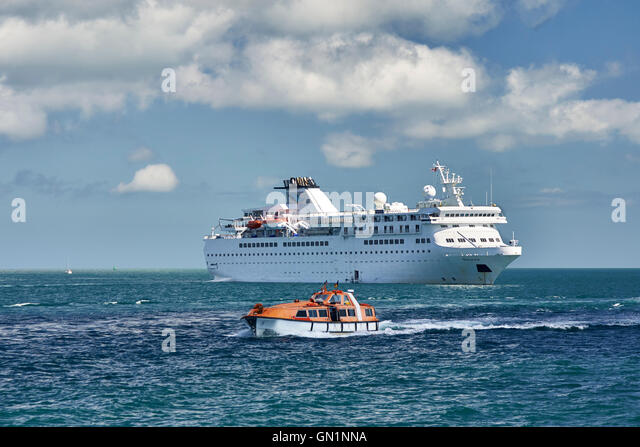 Cruise liners at anchor off St Peter Port Harbour, MV Ventura - Stock Image