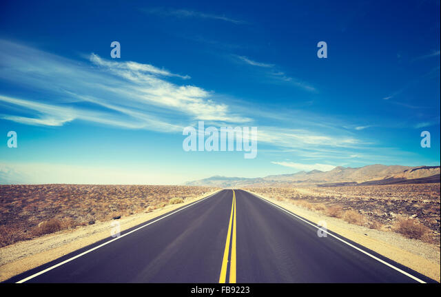 Vintage toned endless country highway, Death Valley, USA. - Stock Image