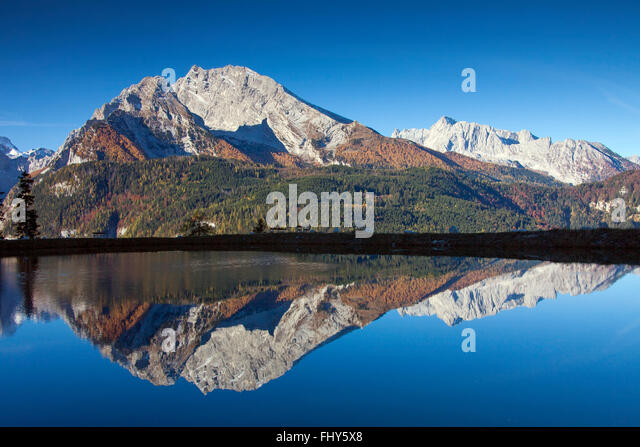 Reflection of Mount Watzmann in a small lake, Bavarian Alps near Berchtesgaden, Bavaria, Germany - Stock-Bilder