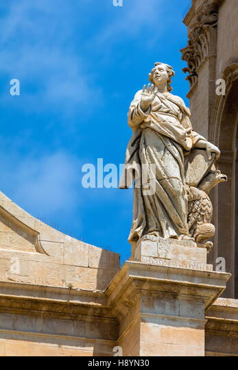 Statue on the facade of the 18th century Noto Cathedral in Noto, Sicily, Italy - Stock Image
