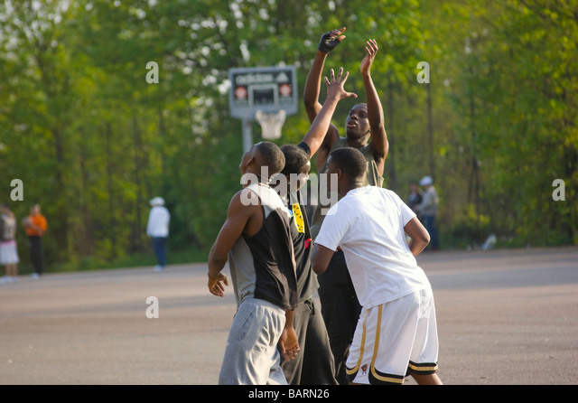 Casual basketball game on a Sunday afternoon in Finsbury Park London England UK - Stock Image