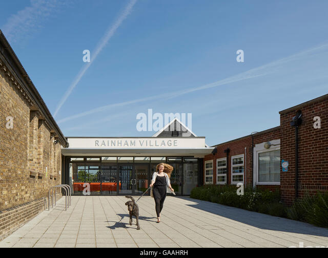 Arrival area with recessed reception. Rainham Village Primary School, Rainham, United Kingdom. Architect: Walters - Stock Image
