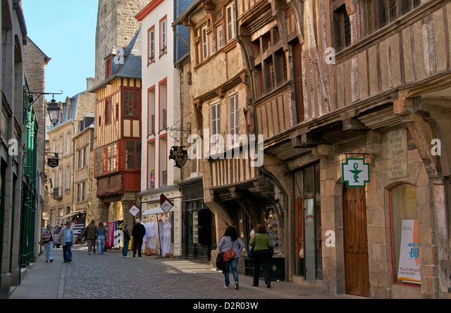 Medieval half timbered houses in streets of old town, Dinan, Brittany, France, Europe - Stock Image