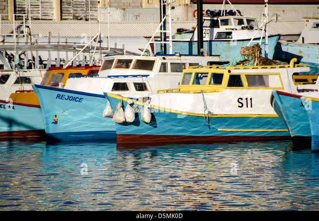 Traditional  wood commercial fishing boats anchored at Fishing Harbour, Bridgetown, Barbados - Stock Image
