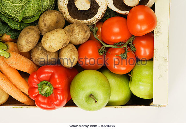 Organic vegetable and fruit box - Stock Image