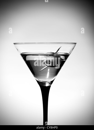 One martinis glass with olive - Stock Image