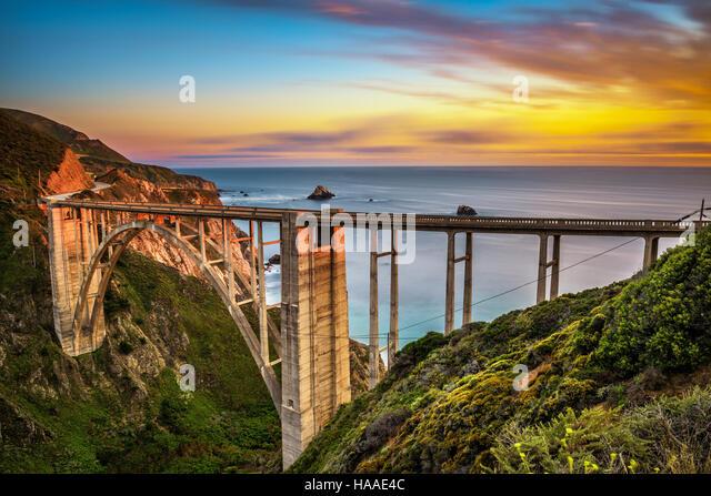 Bixby Bridge (Rocky Creek Bridge) and Pacific Coast Highway at sunset near Big Sur in California, USA. Long exposure. - Stock Image