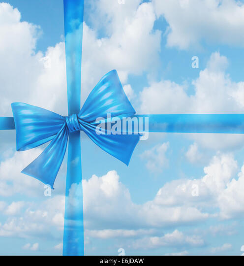 Dream gift from a fantasy wish list concept as an imaginary silk ribbon and bow on a sky background as a symbol - Stock Image
