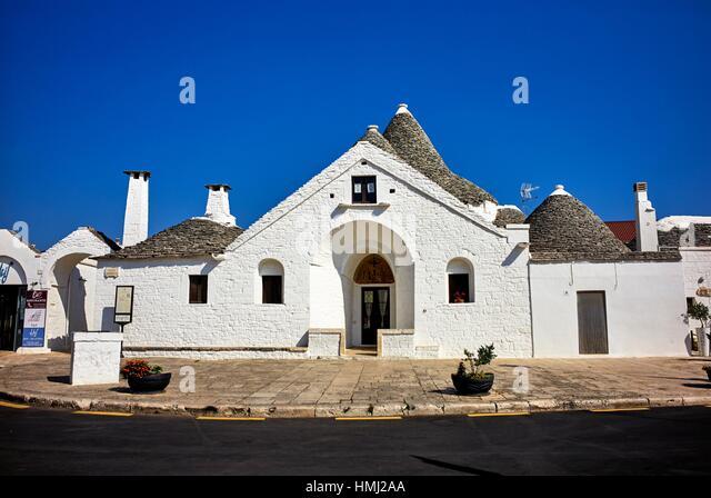 Trullo Sovrano in Alberobello, Apulia, Italy. A trullo (plural, trulli) is a traditional Apulian dry stone hut with - Stock Image