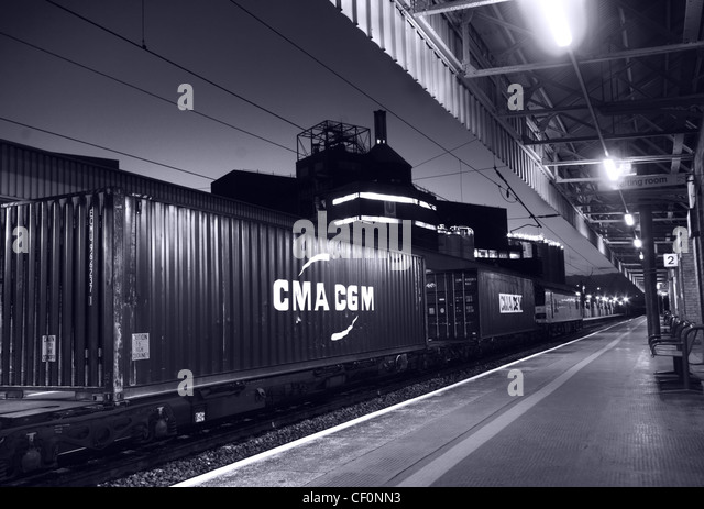 Freight train goes through Warrington Bank Quay, west coast electrified mainline station in Cheshire, England UK - Stock Image