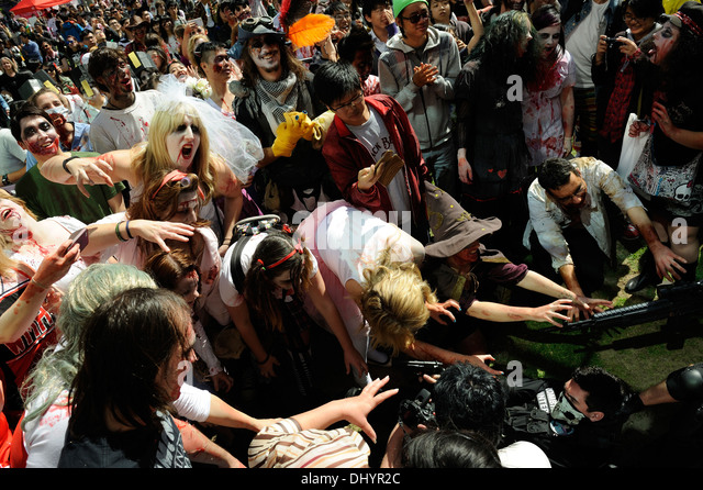 Crowd of Zombies attacking zombie-killers in the inaugural Zombie Walk, Perth, Western Australia - Stock Image