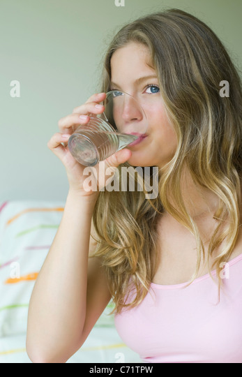 Young woman drinking glass of water - Stock-Bilder