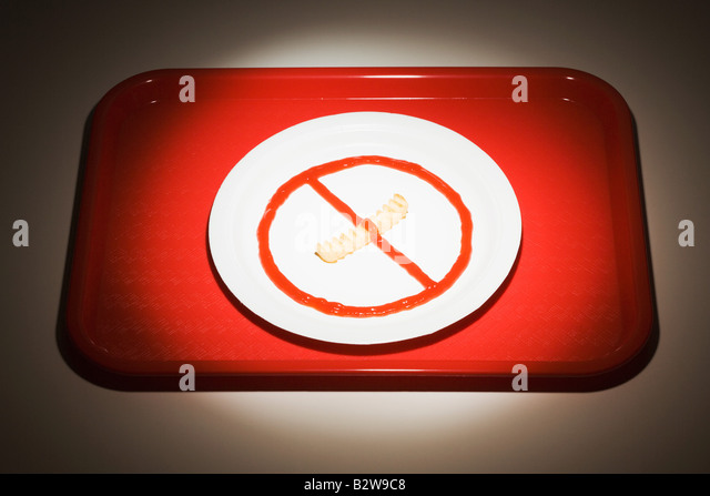 Food arranged on a plate like a no smoking sign - Stock Image