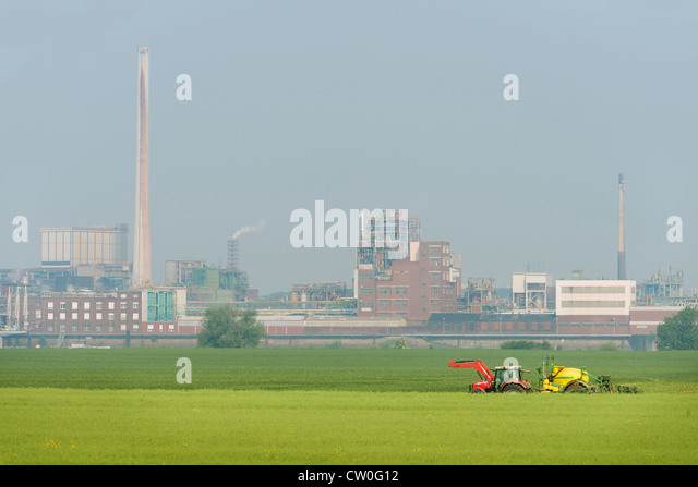 Industrial buildings by fields - Stock Image