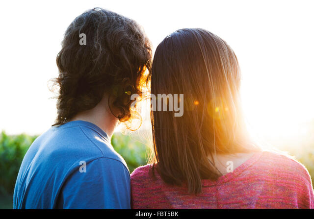 Young couple watching sunset - Stock-Bilder