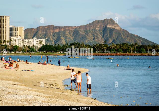 Hawaii Hawaiian Honolulu Ala Moana Beach State Regional Park volleyball game recreation sand Diamond Head Crater - Stock Image