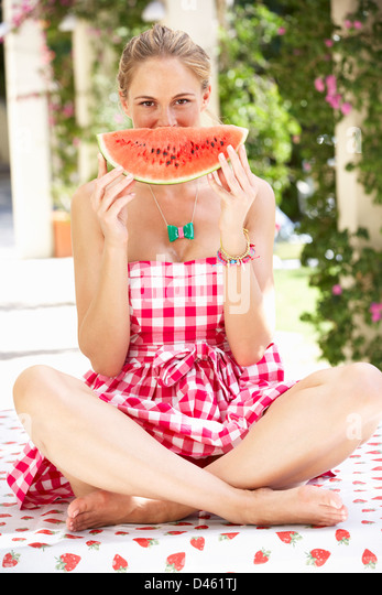 Woman Enjoying Slice Of Water Melon - Stock Image