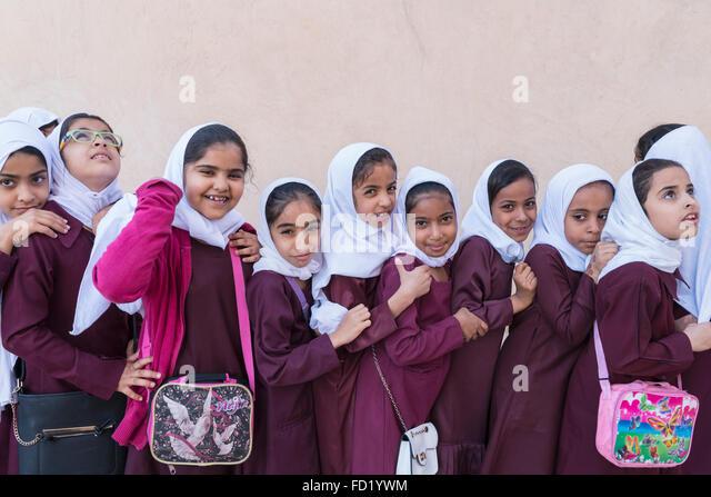 Omani schoolgirls visiting Nizwa Fort in Oman - Stock Image