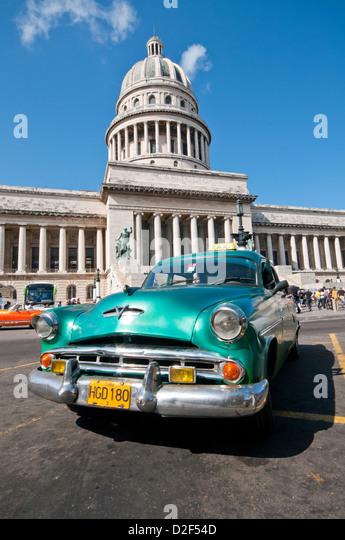 Classic American Dodge Eight Car in Front of Capitolio Building, Habana Vieja, Havana, Cuba, Caribbean - Stock Image