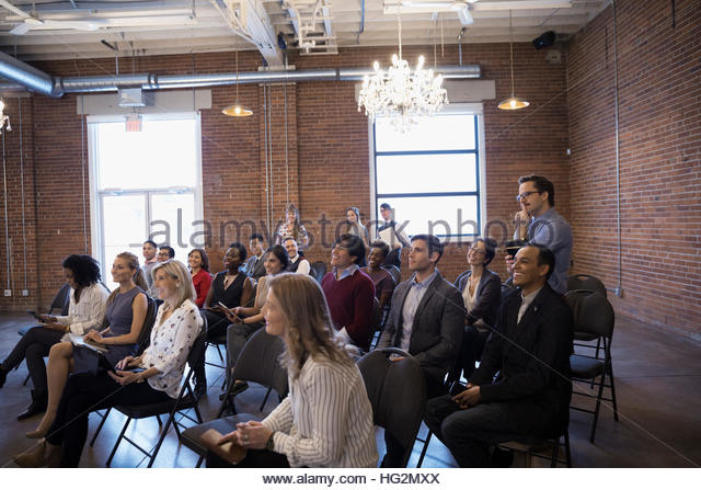 Business people in conference room audience - Stock Image
