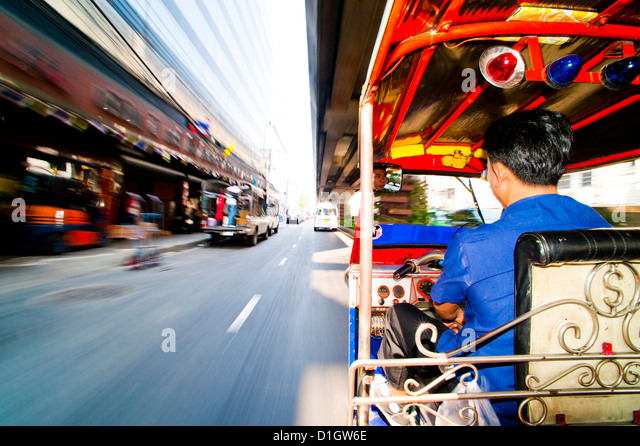 Tuk tuk driver speeding in Bangkok, Thailand, Southeast Asia, Asia - Stock Image
